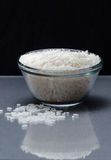 White rice measured in cup Stock Photography