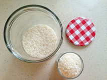 White rice in an open large glass jar Royalty Free Stock Photos