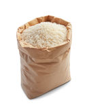White rice. In paper bag isolated on white royalty free stock photography