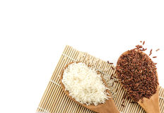 White rice and red rice in wooden spoon Royalty Free Stock Images