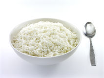 White Rice With Spoon; 1 of 2. White rice in a bowl with a spoon placed on the side (front view version Stock Photo