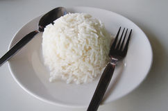 White rice. White stream rice with fork and spoon Royalty Free Stock Images