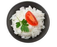White rice with tomato in black bowl isolated on white background. top view stock photos