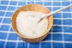White Rice in Wood Bowl on Blue Towel Stock Photos
