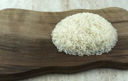 White rice on wooden board. Round shaped Stock Photos