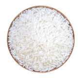 White rice in a wooden bowl isolated on white background, clippi Stock Photography