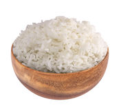 White rice in a wooden bowl isolated on white background, clippi Royalty Free Stock Images