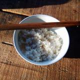 White rice on the wooden floor stock photos