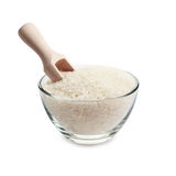 White rice and wooden scoop. In glass bowl isolated on white background Stock Photography