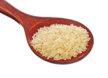 White rice in wooden spoon Royalty Free Stock Image