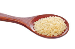 White rice in wooden spoon Royalty Free Stock Photo