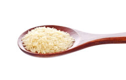 White rice in wooden spoon Stock Photo