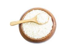 White rice on wooden spoon in a wooden bowl Royalty Free Stock Photos