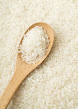 White rice on wooden teaspoon Stock Images