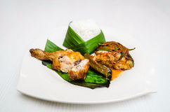 White Rice. A wrapped white rice in plate on a dining table served with fried chicken and a portion of fish stock images