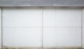 White ridged garage metal wall, background. Photo texture Royalty Free Stock Photo
