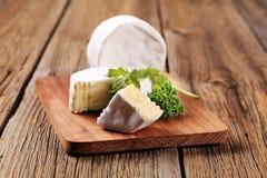White rind cheese Stock Photos
