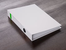 White ring binder on a table. Ring binder on a table close-up Royalty Free Stock Photo