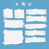 White ripped notebook, copybook sheets, stars stuck with sticky tape on blue dotted pattern. Royalty Free Stock Images