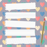 White ripped ruled notebook, copybook, note paper strips with pencil stuck on pattern created of colorful heart shapes Stock Image