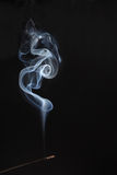 White rising smoke from aromatic stick Royalty Free Stock Images