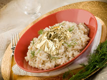 White risotto with gold leaf Stock Photos