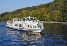 White river boat autumn season. White excursion boat at the river during autumn season with forest background Royalty Free Stock Photography