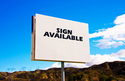 White roadside billboard. On the sky background Stock Images