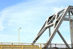 White Roadway River Bridge. White steel, truss roadway river bridge Stock Images