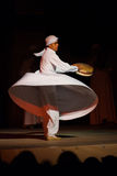 White Robe Whirling Dervish Sufi Dance Cairo. CAIRO, EGYPT - JULY 3, 2010: A Sufi dancer in white spins and beats a drum during a whirling dervish at an open air Stock Images