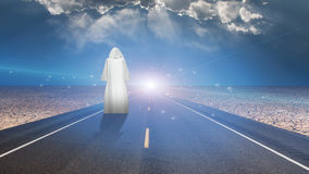 White robed man and road Royalty Free Stock Images