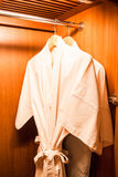 White robes with wooden hangers Royalty Free Stock Photos
