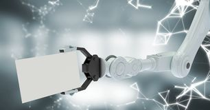 White robot claw with card and white interface against blurry grey room Royalty Free Stock Images