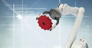 White robot claw red cog against white interface, cloud, flare and blue background Stock Image