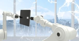 White robot claws with device against white interface and window with skyline Stock Photos
