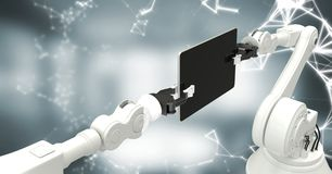 White robot claws with device and white interface against blurry grey room Royalty Free Stock Images