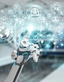 White robot hand using cyber security data interface 3D renderin. White robot hand on blurred background using cyber security data interface 3D rendering Royalty Free Stock Photography