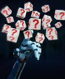 White robot hand using digital question marks 3D rendering. White robot hand on blurred background using digital question marks 3D rendering Stock Images