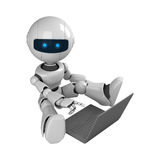 White robot sit with laptop Royalty Free Stock Photos