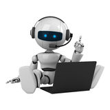 White robot sit with laptop and headphones Stock Image