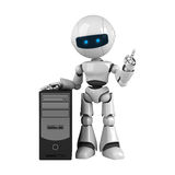 White robot stay with computer Royalty Free Stock Photos