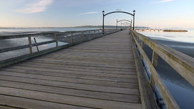 White Rock Pier Morning dolly shot. White Rock Pier, BC. White Rock is a popular tourist destination on the west coast of British Columbia near the United States stock footage