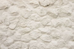 White Rock Stone. The White natural stone wall background Royalty Free Stock Photos