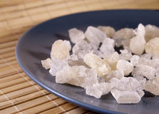 White rock sugar on the plate Royalty Free Stock Image