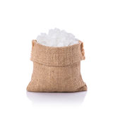 White rock sugar in small sack. Studio shot isolated on white  Royalty Free Stock Photo