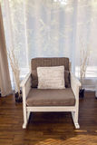 White rocking chair with brown cushion in the interior Royalty Free Stock Image