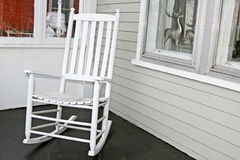 White rocking chair on porch. Vintage white rocking chair on front porch Stock Photos
