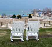 White rocking chairs overlooking the lake Royalty Free Stock Photos