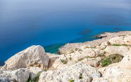 White rocks and blue sea, minimalistic sea background and textur Royalty Free Stock Images