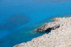 White rocks and blue sea, minimalistic sea background and textur Stock Photos